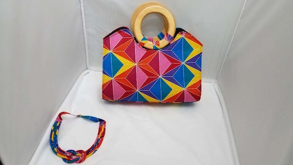 red, blue, and yellow floral print handbag