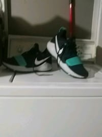 pair of black-and-white Nike basketball shoes Regina, S4T 4J2