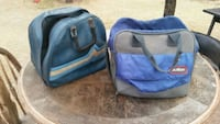 two blue fabric bowler bags