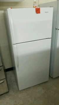Whirlpool white Refrigerator good condition  Laurel, 20707