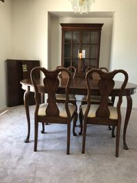 OBO Just Reduced:  inclds 8 pieces  Canadian Queen Anne Good Condition Dining Room Suite Solid Cherry Includes: 4xchairs , 2x leave extension 1x hutch 1x table Edmonton, T6W 1A5