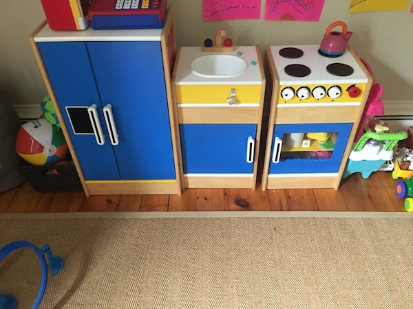 Blue, white, and brown wooden kitchen playset