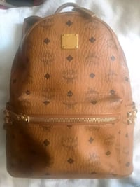 brown leather MCM backpack screenshot 3745 km