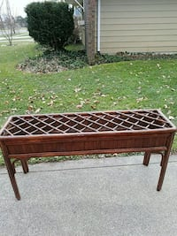 brown wooden framed glass-top table 281 mi