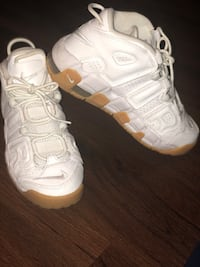 Pair of white nike basketball shoes