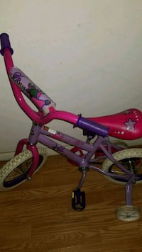 toddler's pink and purple bicycle 959 mi