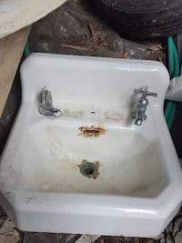 1910 cast iron clawfoot tub and matching wall sink Vancouver
