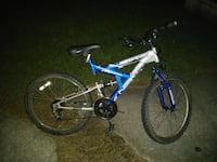 blue and gray Next full suspension mountain bike