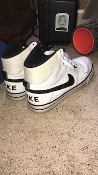 pair of white-and-black Nike basketball shoes Rockfall, 06481