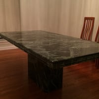 """Solid Marble dining table. 78 3/4"""" x 39 1/4"""" x 30"""" high. One owner excellent condition. One of-a-kind heirloom. Negotiable. Garage level ready to move. Local pick-up only. Will not ship. Marlborough, 63123"""