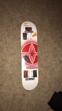 White and red skateboard deck
