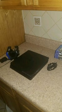 black Sony PS4 console with controller and game cases Yonkers, 10701