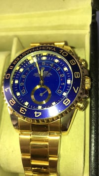 round blue Rolex analog watch