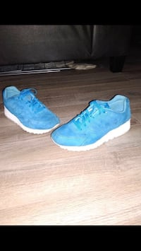 pair of blue Nike running shoes Coppell, 75019