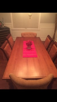 Dining table and chairs.  4 chairs and 2 captain chairs