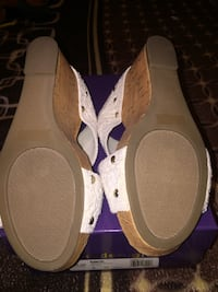 pair of off white slip on shoes