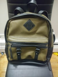brown and black Herschel leather backpack