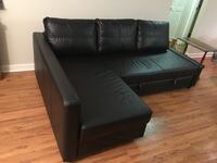 Black leather tufted sofa with throw pillows Fairfax, 22033