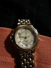 round silver analog watch with silver link bracelet