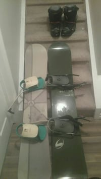 two white and green snowboards