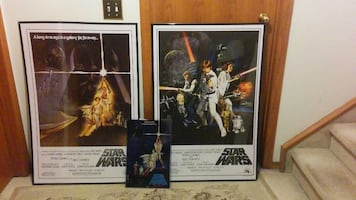 two Star Wars posters