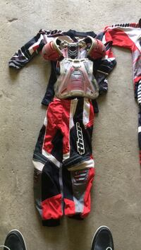 Red, blue and white Thor motorcycle overall suit Sherman, 06784