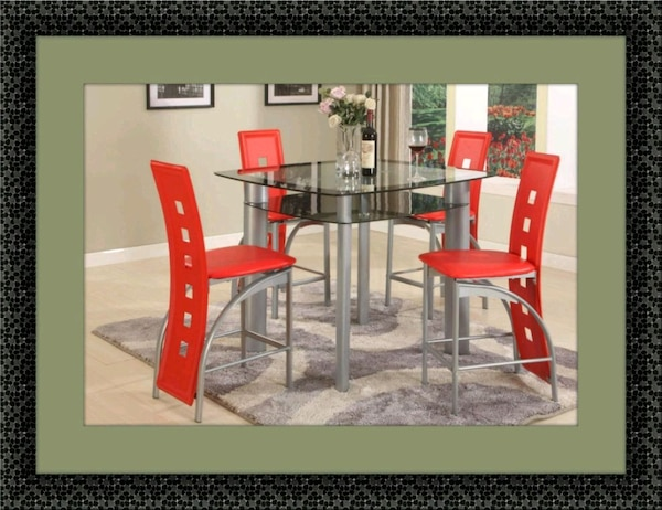 Red counter height table with 4 chairs