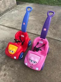 two toddler's assorted-color Step2 ride-on toys