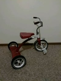 toddler's red and white trike Madison