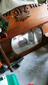 brown wooden framed glass top coffee table 434 mi
