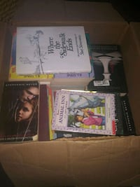 Medium size box full of different kinds of books