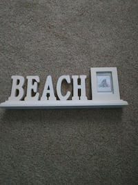 Beach themed, seashell is cross stitched Mount Carmel