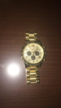 Gold link white face chronograph watch