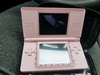 white Nintendo DS with case 620 km