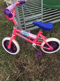 toddler's pink and white bicycle 1213 mi