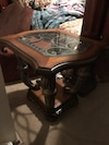 Brown wooden framed clear glass end table