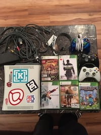 Xbox 360 console with controller and game cases