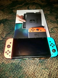 white and red Nintendo Switch