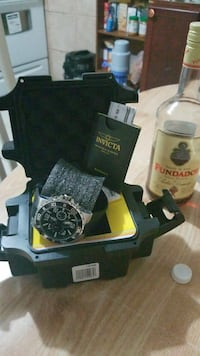 round black and silver-colored Invicta chronograph watch with black strap