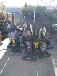 two black and one red upright vacuum cleaners Denver, 80221