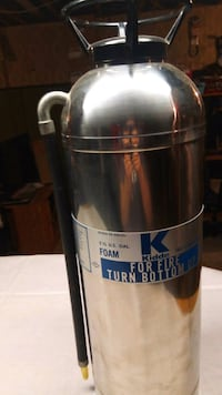 Stainless steel extinguisher 50 years old