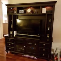 brown wooden TV hutch with flat screen television Lorton, 22079