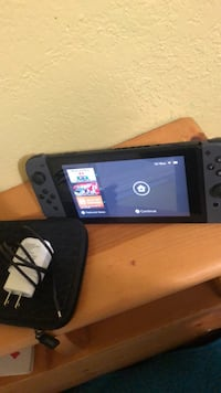 Nintendo Switch only the switch included with charger and multiple games