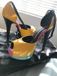 pair of black-and-orange platform stilettos Toronto