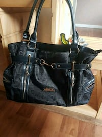 Black leather a d material with zippers purse Surrey, V3T 5E2