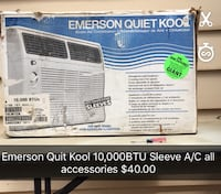 white Emerson window-type air conditioner box with text overlay