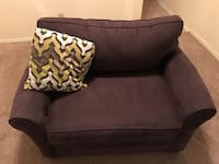 black and brown fabric sofa chair