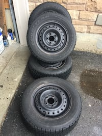 set of 4 tires and rims winter Goodyear good condition size tires and 215/60R15 Brampton, L6R 3M6