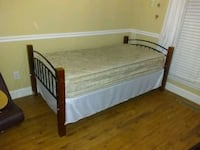 Twin bed black metal and wood posts. Cleveland