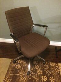 Brown rolling desk chair 553 km